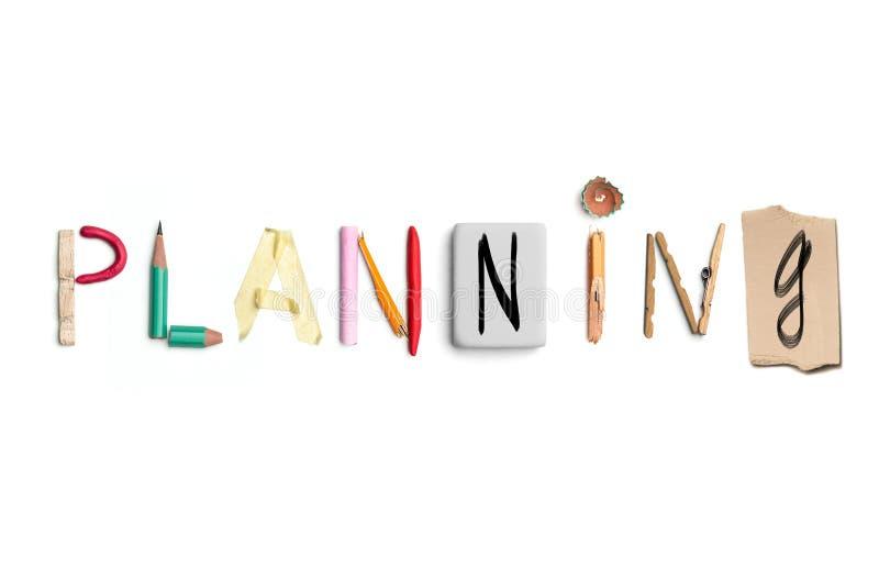 De woord planning leidde tot van bureaukantoorbehoeften stock afbeeldingen