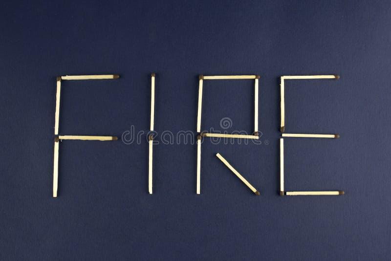 De woordbrand van gelijken op een blauwe gelijke wordt opgemaakt die als achtergrond royalty-vrije stock fotografie