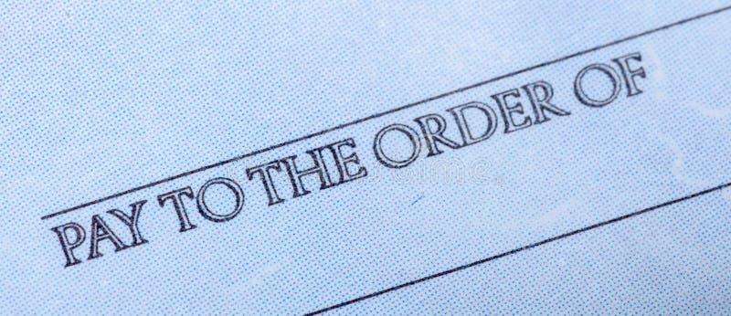 De woorden ` betalen aan de Orde van ` op een Chek - sluit omhoog royalty-vrije stock foto