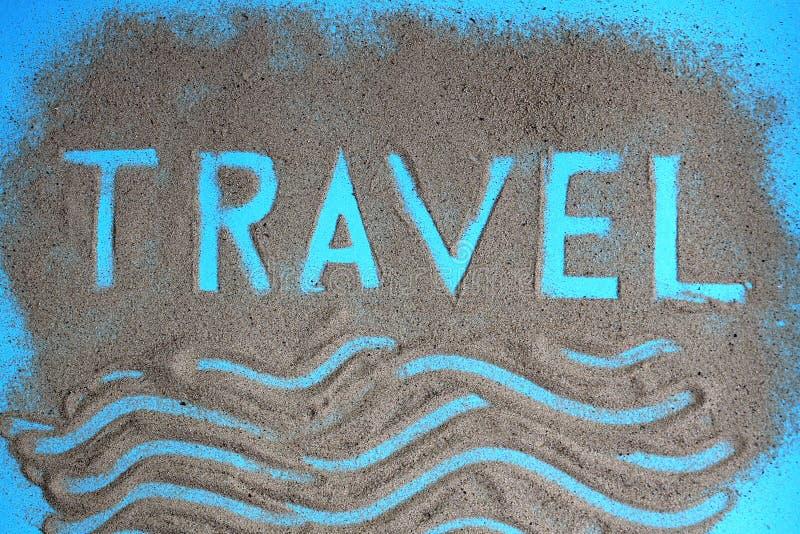 De woordreis wordt geschreven op het zand royalty-vrije stock foto