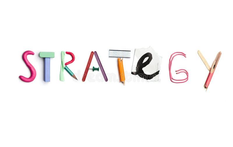 De woordstrategie leidde tot van bureaukantoorbehoeften royalty-vrije stock afbeeldingen