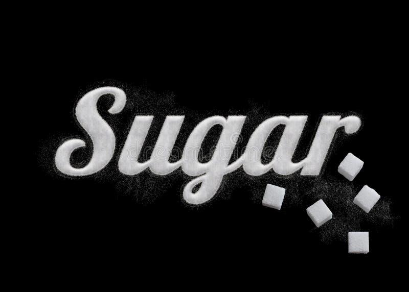 De woordsuiker door suikerkorrels die wordt geschreven stock foto