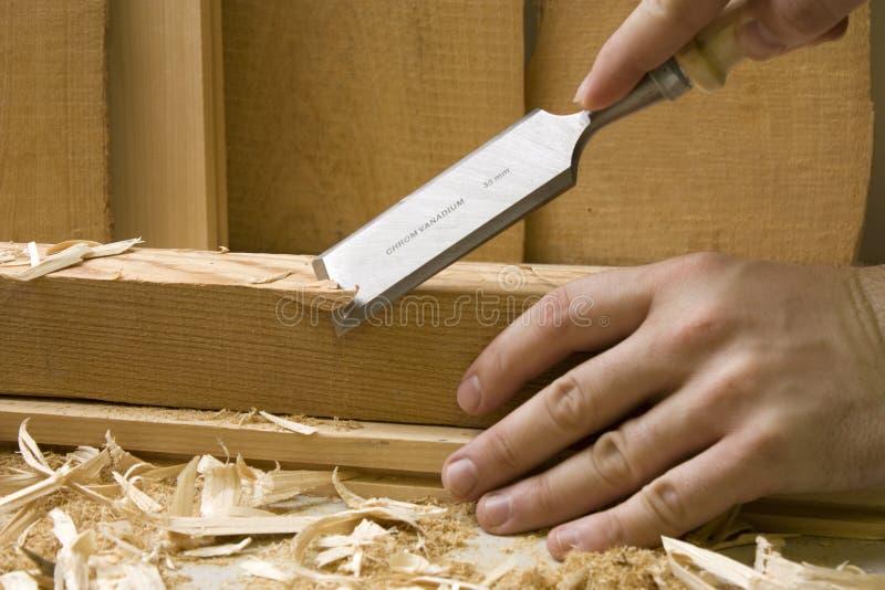 De workshop van de schrijnwerkerij met houten hulpmiddelen stock foto