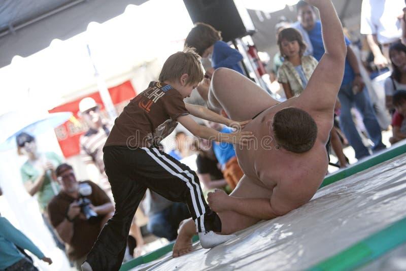 De Worstelaar en het Kind van Sumo royalty-vrije stock fotografie
