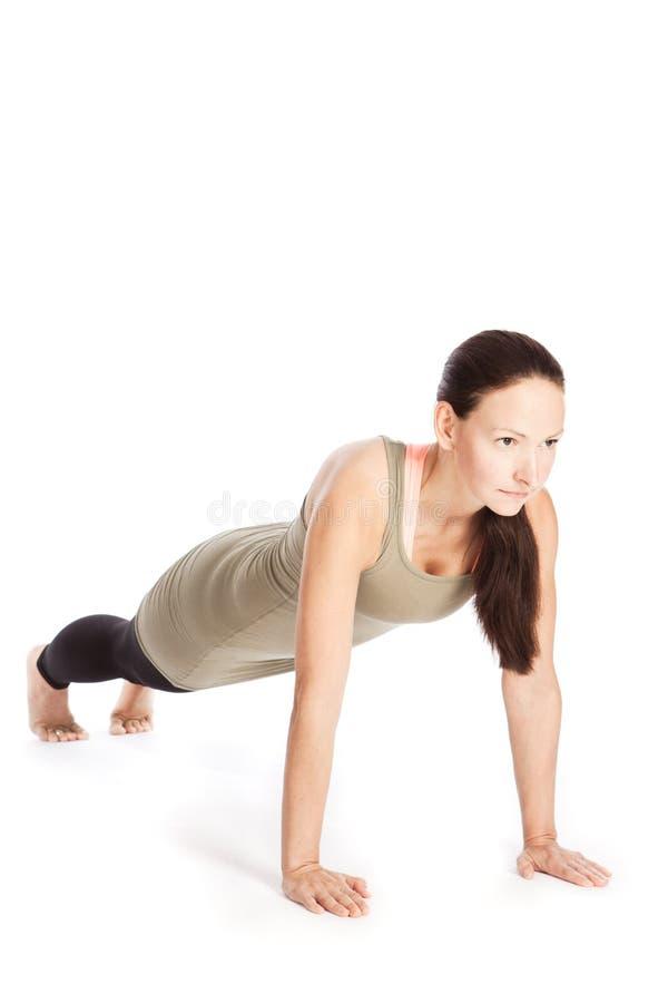 De yoga stelt in studio stock fotografie