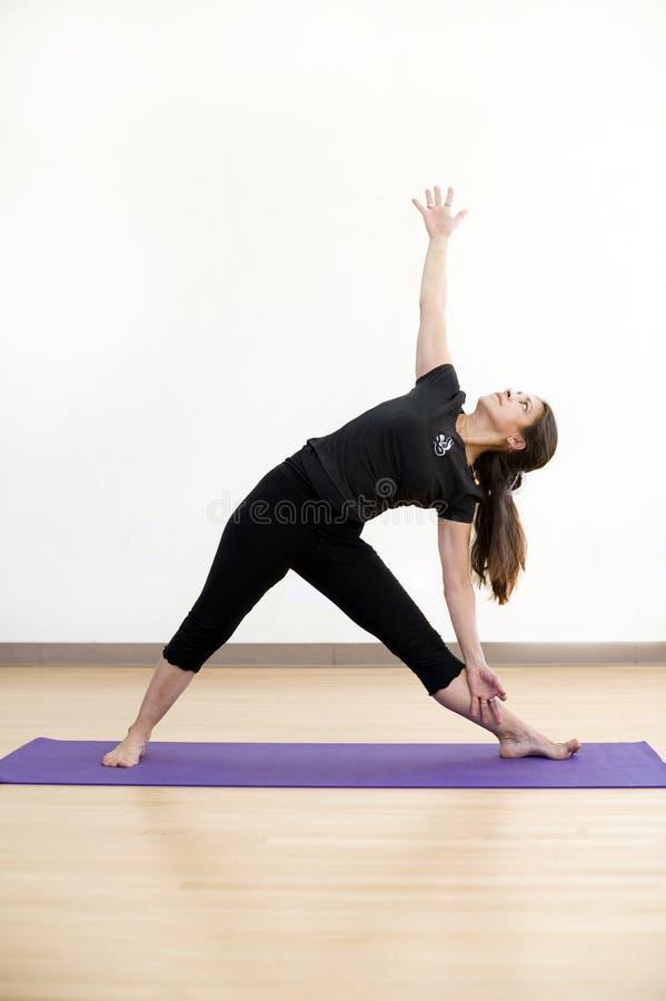 De Yoga van de driehoek stelt royalty-vrije stock afbeeldingen