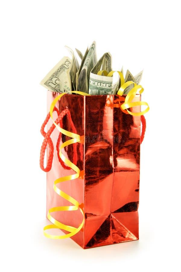 De zak van de gift met dollars royalty-vrije stock afbeeldingen