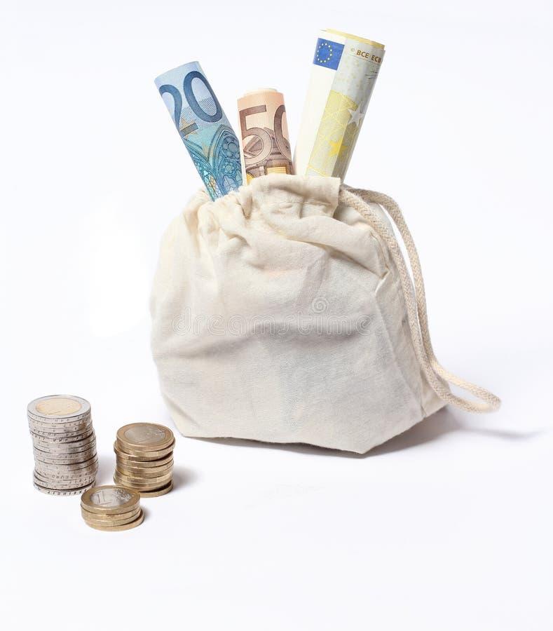 De zak van het geld met rekeningen en muntstukken royalty-vrije stock foto's
