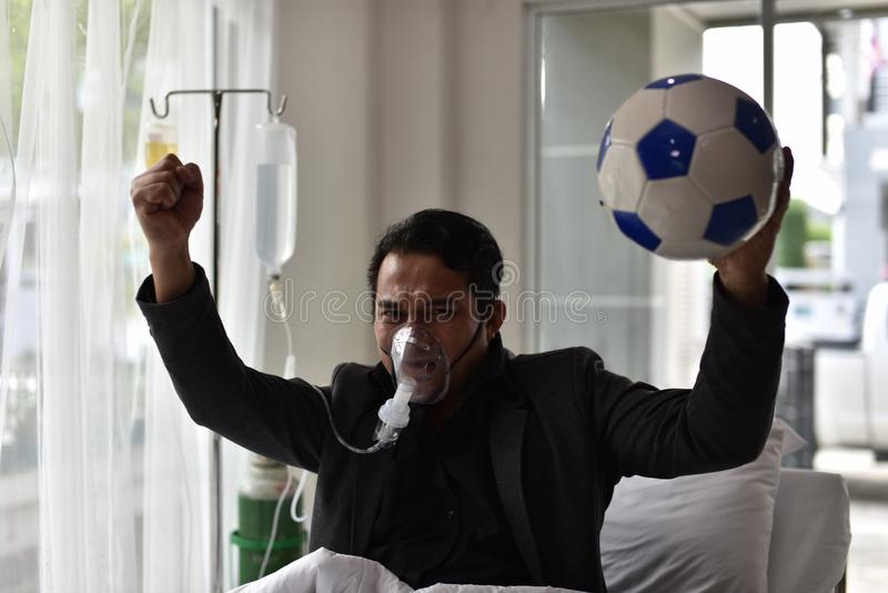 De zakenlieden hebben nog een toejuiching voor voetbal royalty-vrije stock afbeeldingen