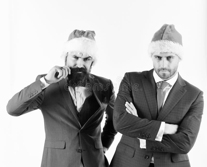De zakenlieden met zeker gezichten huidig team werken royalty-vrije stock afbeelding