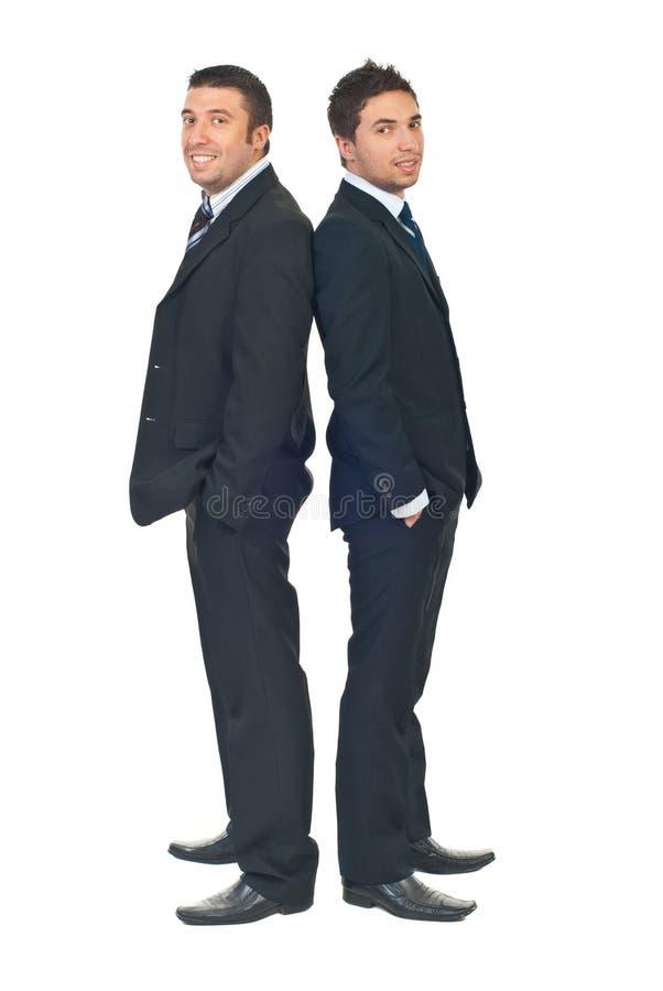 De zakenlieden van de schoonheid in zwarte kostuums stock afbeelding