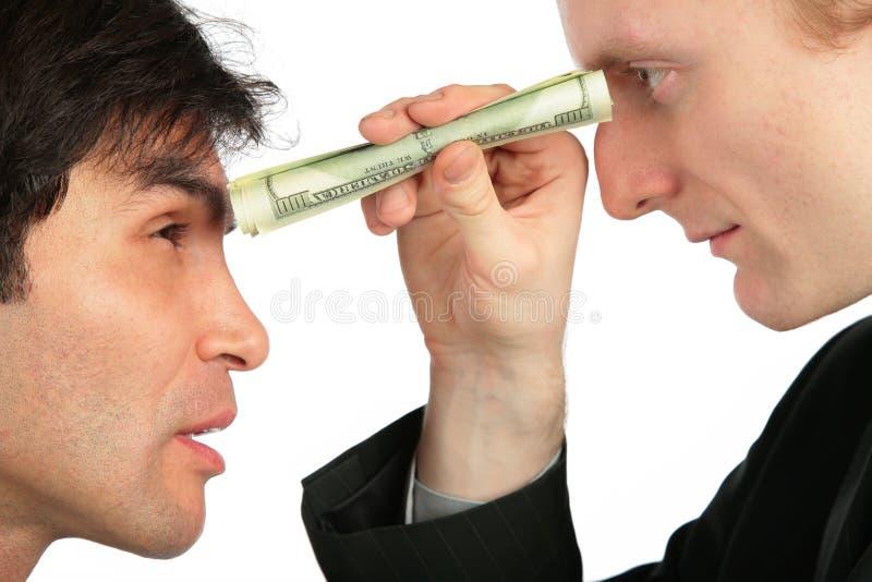 De zakenman bekijkt een andere door buis royalty-vrije stock foto