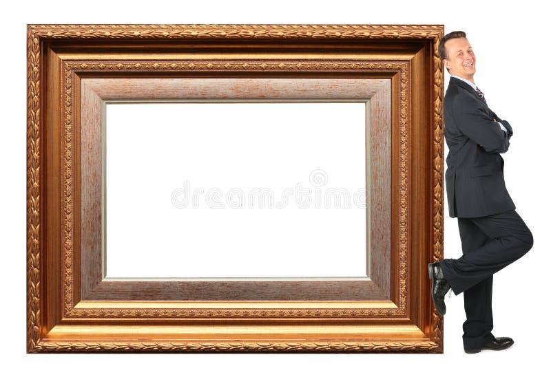 De zakenman bevindt zich dichtbij Omlijsting baget stock foto's