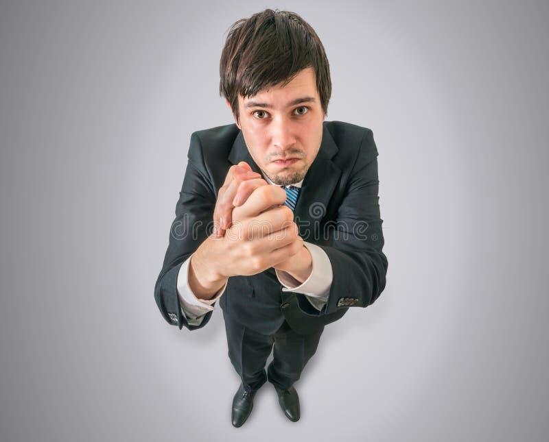 De zakenman bidt of vraagt om hulp Mening vanaf bovenkant stock fotografie