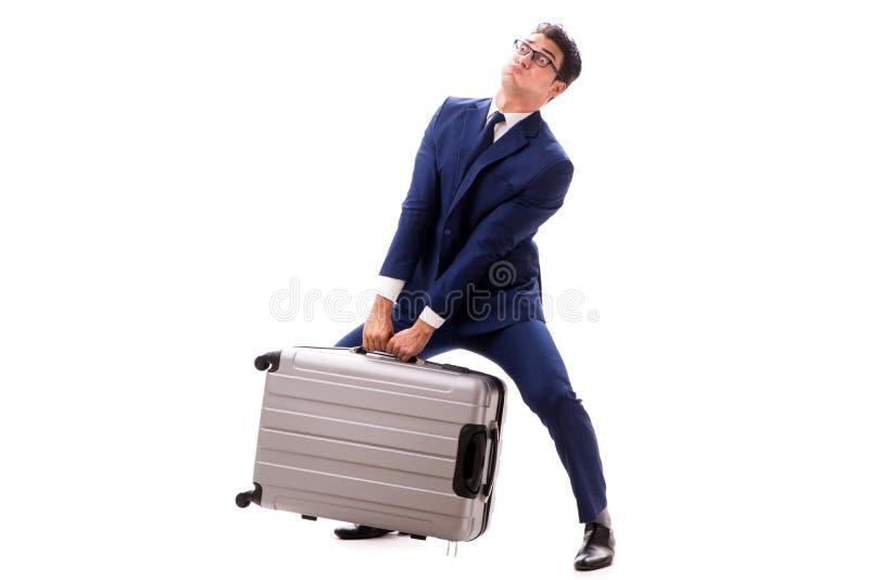 De zakenman die bovenmatige lasten toe te schrijven aan zware koffer onder ogen zien royalty-vrije stock afbeelding