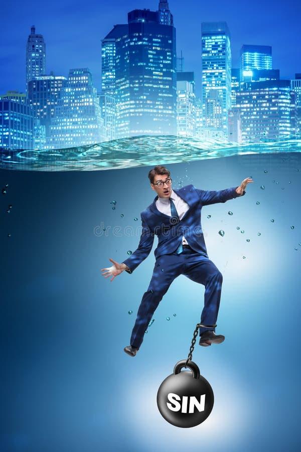 De zakenman die onder de last van zonde en schuld verdrinken stock foto