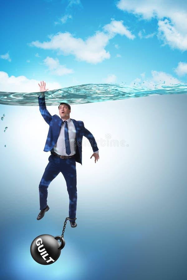 De zakenman die onder de last van zonde en schuld verdrinken stock foto's