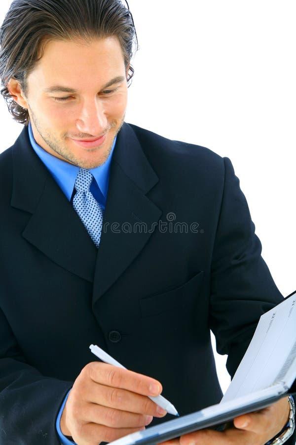 De Zakenman die van de close-up Agenda bekijkt stock foto
