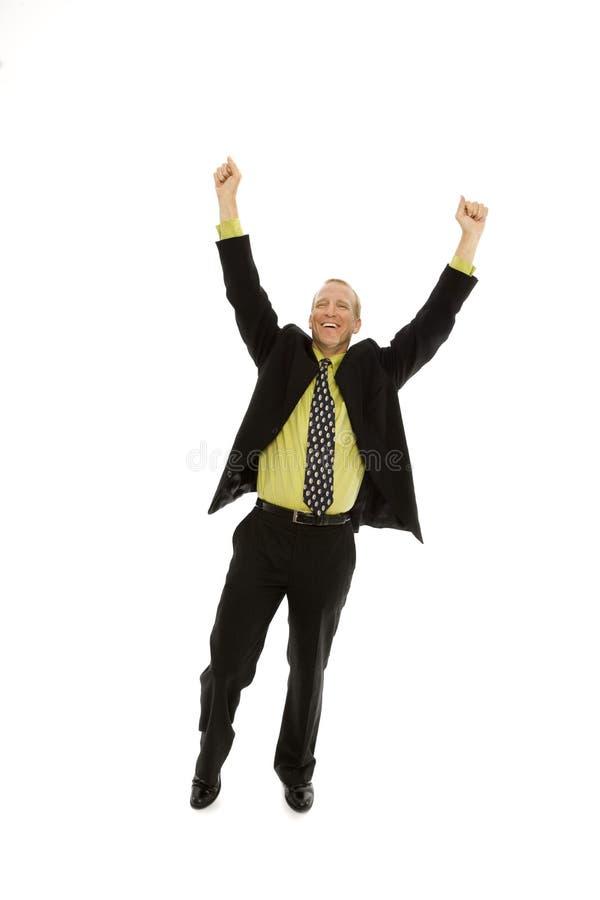 De zakenman drukt triomf uit stock fotografie