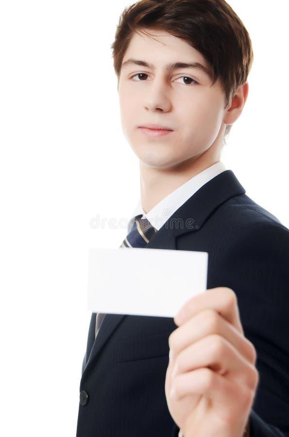 De zakenman in een pak met visitekaartje royalty-vrije stock afbeeldingen