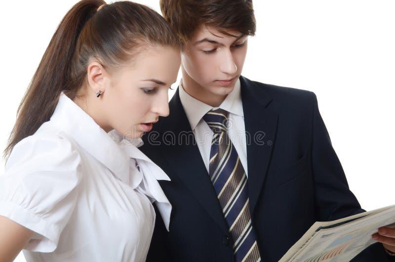 De zakenman en de onderneemster met klembord royalty-vrije stock foto