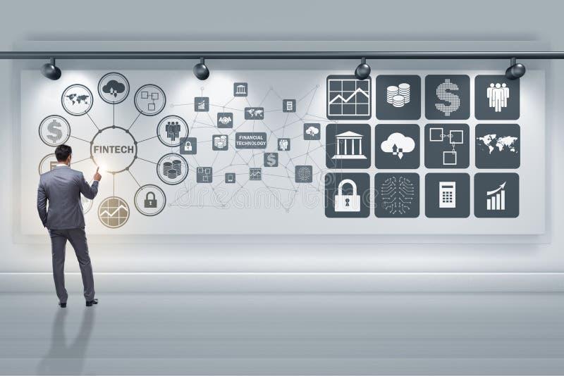 De zakenman in financieel technologie fintech concept stock fotografie