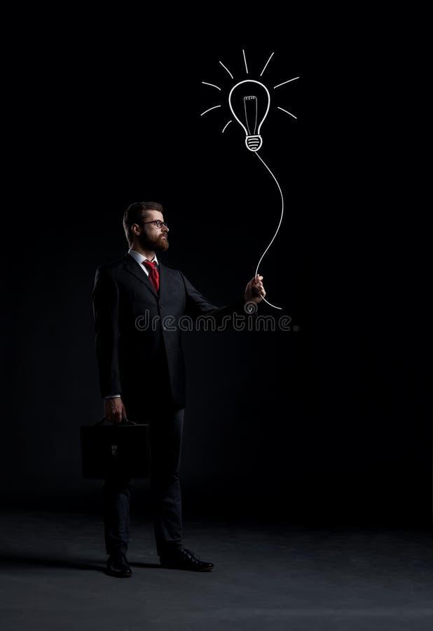 De zakenman heeft een idee stock fotografie