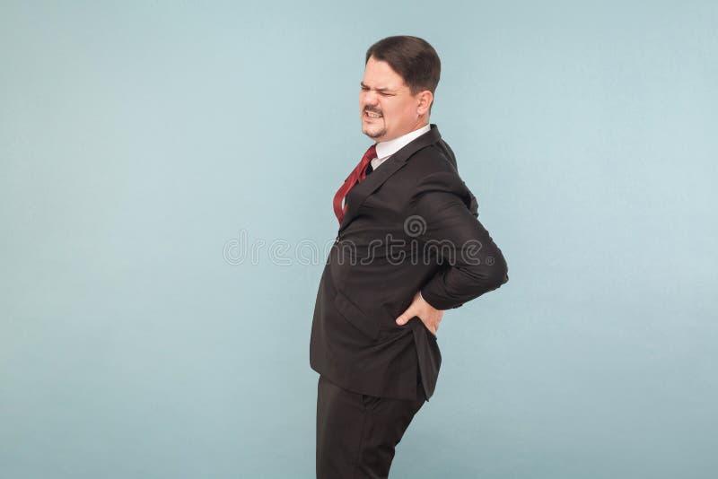 De zakenman heeft nier, lagere rug of ingewandsbreukpijn stock foto's