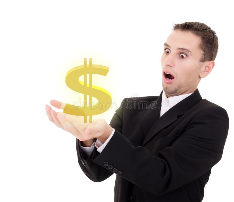 De zakenman kiest gouden de dollarteken van de V.S. stock foto's