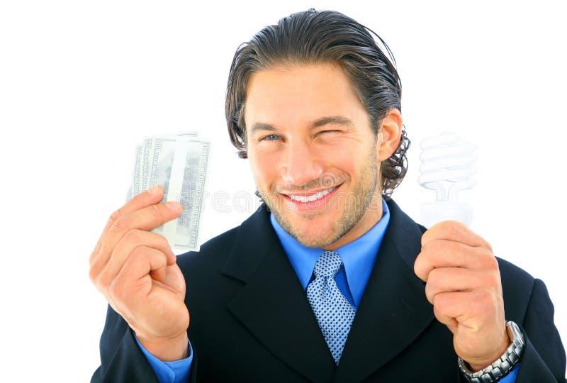 De zakenman knipoogt over Geld en Energie stock afbeelding