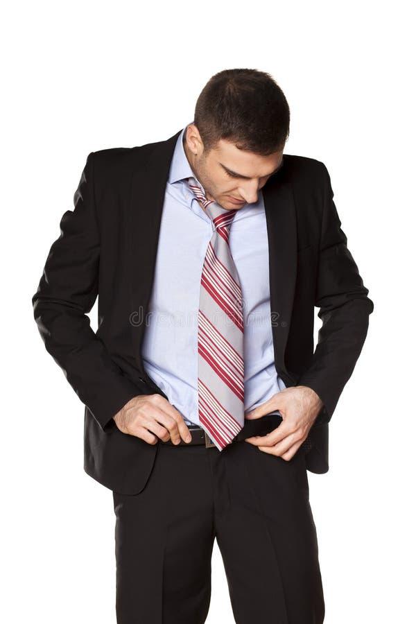 De zakenman maakte de riem vast stock fotografie