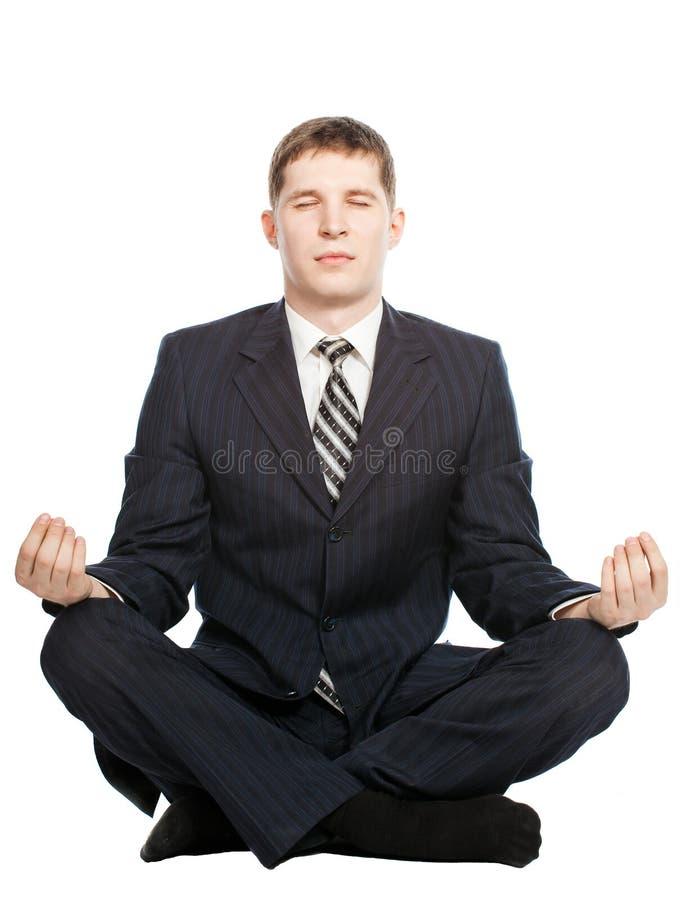 De zakenman mediteert, Geïsoleerde op wit royalty-vrije stock afbeeldingen