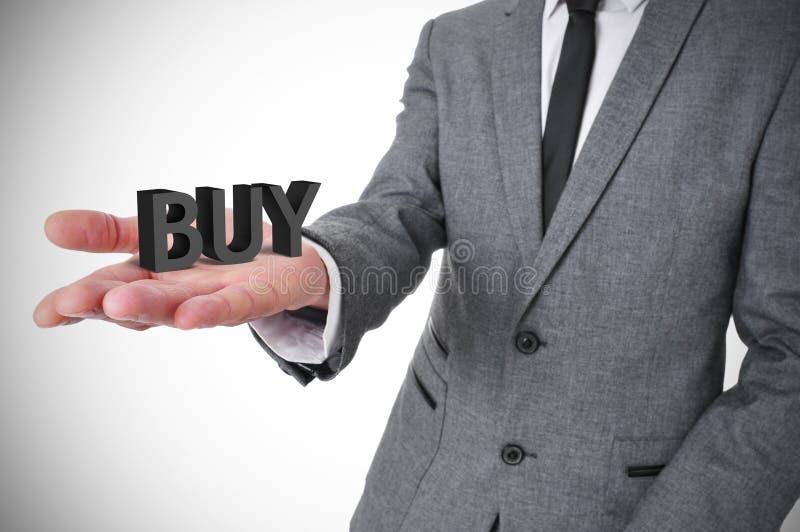 De zakenman met het woord koopt zijn hand in royalty-vrije stock afbeeldingen