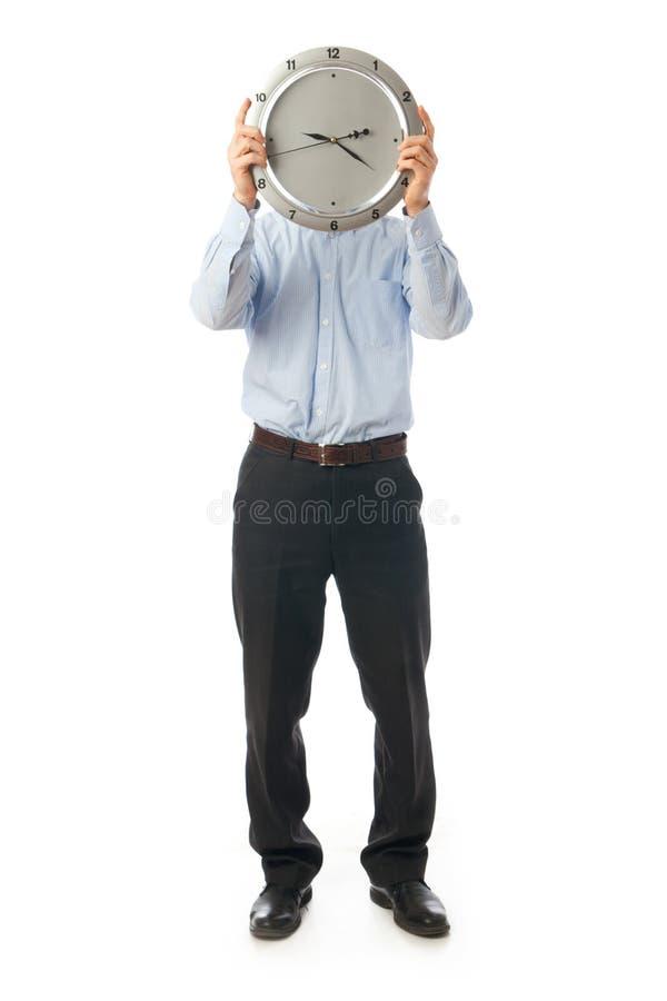 De zakenman met klok die op een wit wordt geïsoleerdo royalty-vrije stock afbeeldingen