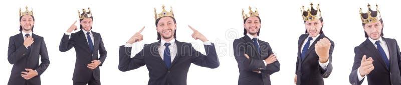 De zakenman met kroon op wit wordt geïsoleerd dat stock fotografie