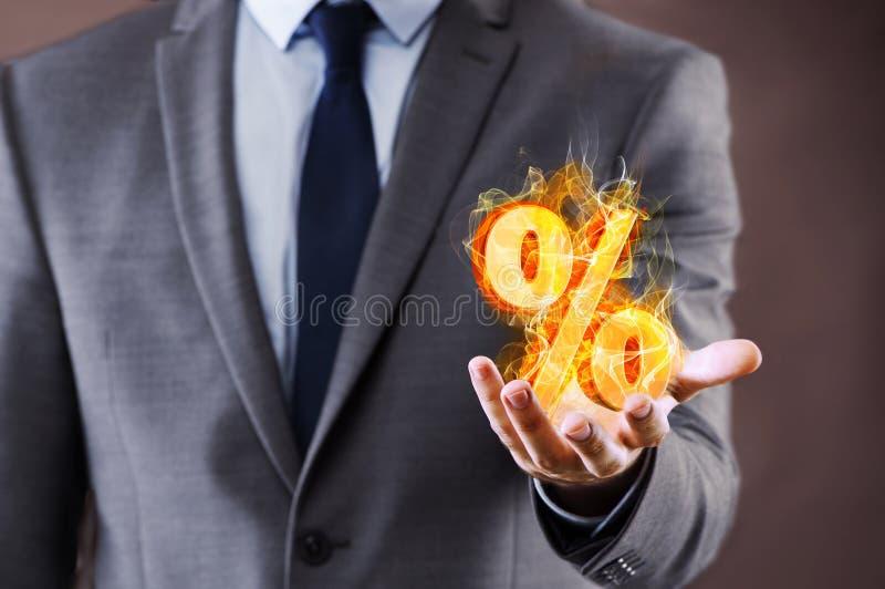 De zakenman met percenten ondertekent in hoog renteconcept royalty-vrije stock foto