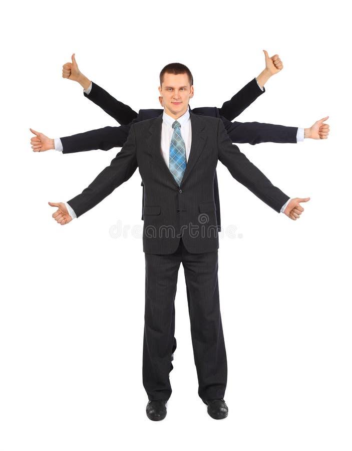 De zakenman met zes handen toont gebaar o.k. stock fotografie