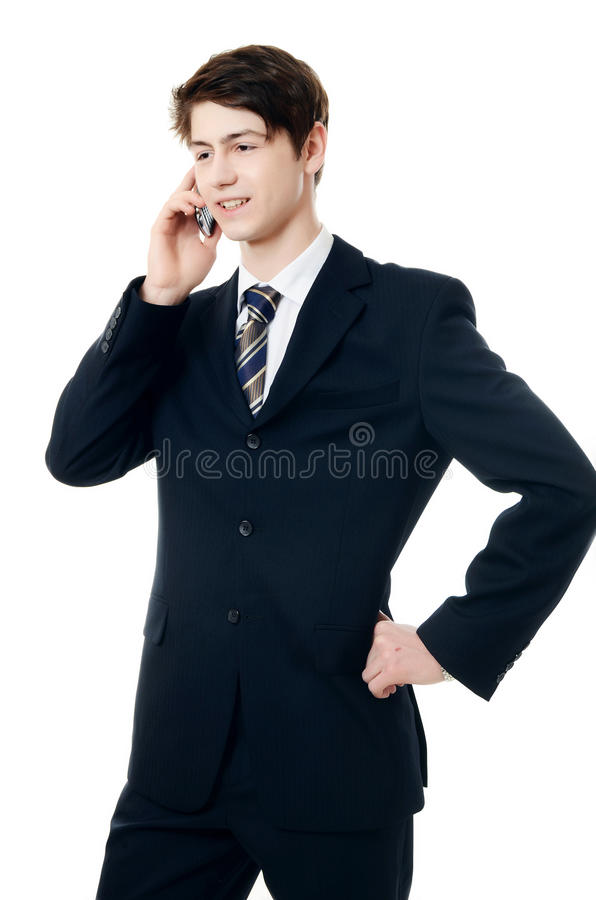 De zakenman in pak spreekt telefonisch royalty-vrije stock afbeelding