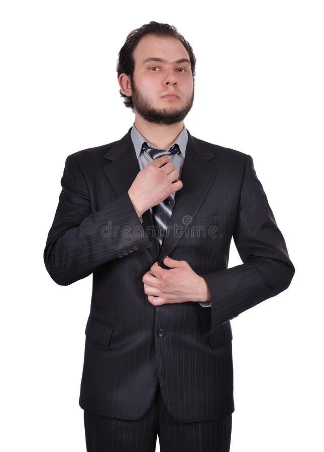 De zakenman past zijn band aan stock afbeelding