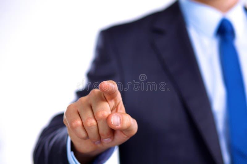 De zakenman richt zijn vinger op het doel stock fotografie