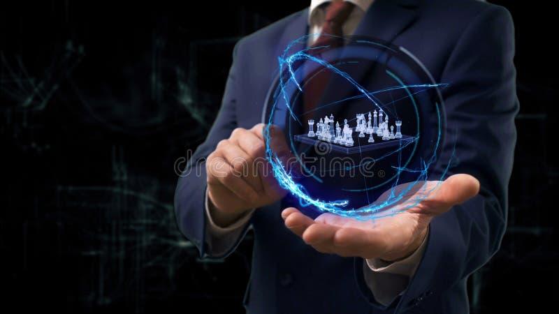 De zakenman toont conceptenhologram 3d schaak op zijn hand stock afbeeldingen