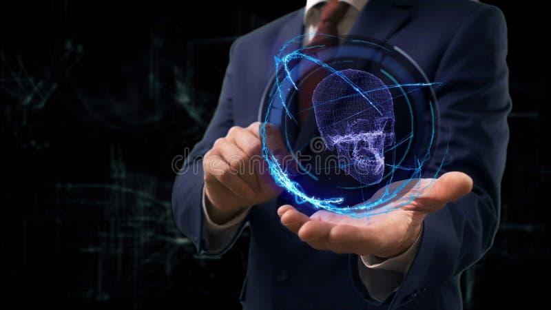 De zakenman toont conceptenhologram 3d schedel op zijn hand royalty-vrije stock afbeelding