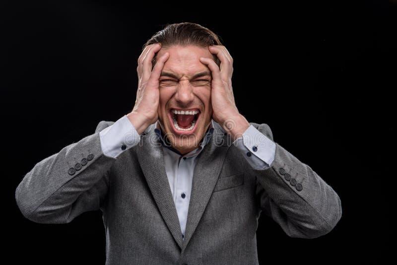 De zakenman toont zijn slechte emoties aan royalty-vrije stock foto