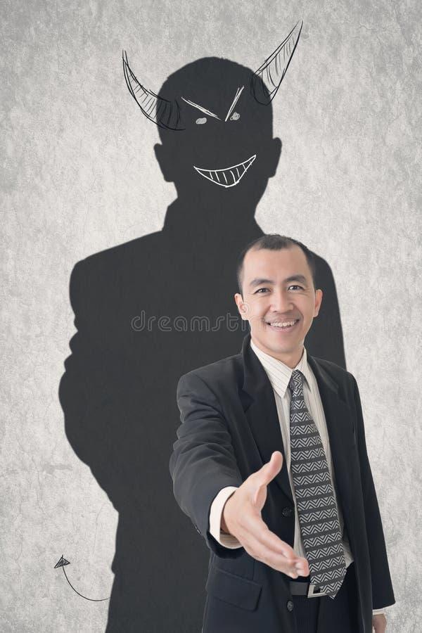 De zakenman van de duivel stock foto's