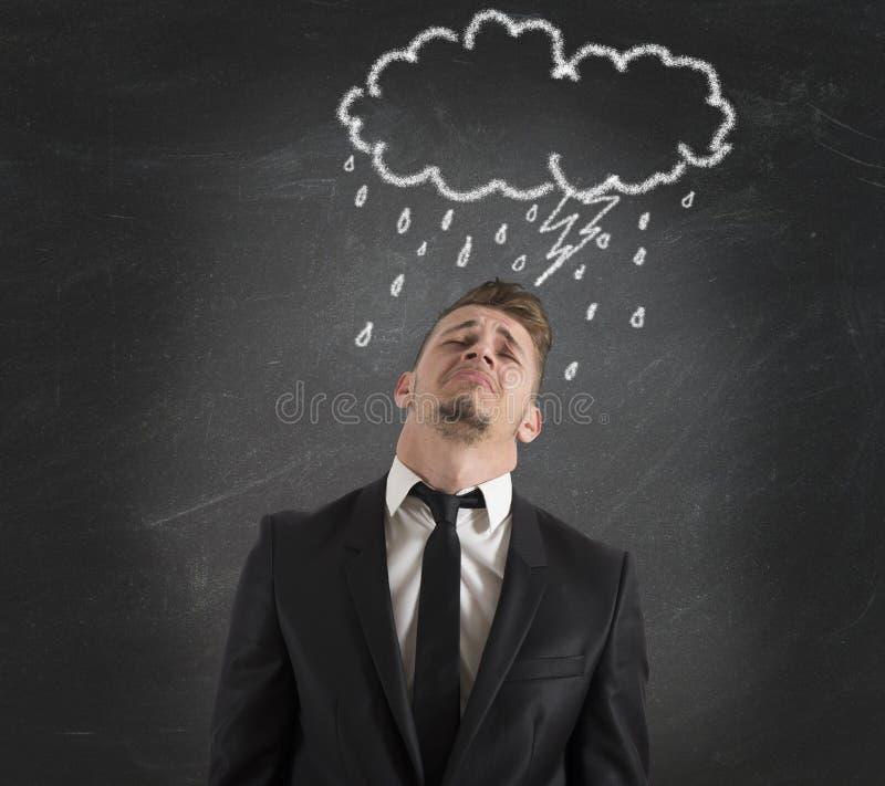 De zakenman van de pessimist voor de crisis stock foto