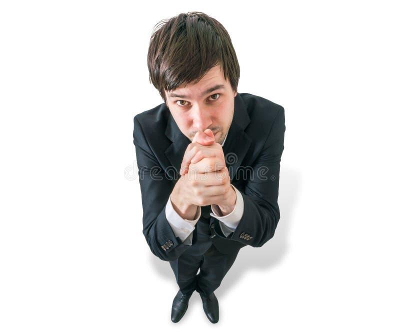 De zakenman vraagt om hulp of het los krijgen Mening vanaf bovenkant royalty-vrije stock foto
