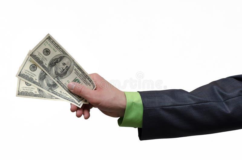 De zakenmanhand rekt een dollarsgeld uit dat op grijze achtergrond met exemplaar ruimteachtergrond wordt geïsoleerd Financiële hu royalty-vrije stock foto