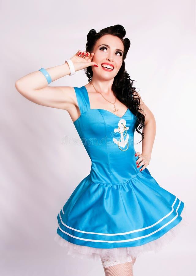 De zeemansspeld op meisje met helder maakt omhoog. stock afbeelding