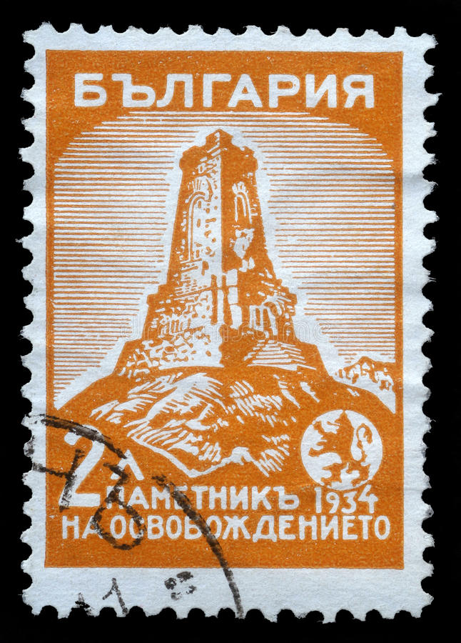 De zegel in Bulgarije wordt gedrukt toont Shipka-monument dat stock foto's