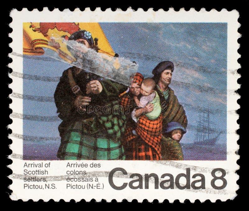 De zegel die door Canada wordt gedrukt, toont Schotse Kolonisten stock foto